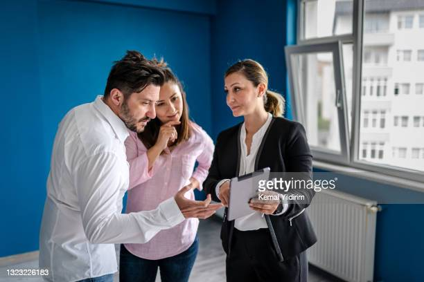 real estate agent and young couple making deals for property - real estate developer stock pictures, royalty-free photos & images