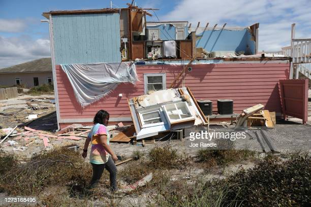 Christine Cortazal checks in on an apartment building that she manages after the roof was blown off when Hurricane Sally passed through the area on...