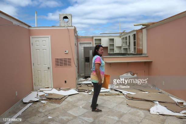 Christine Cortazal checks in on an apartment that she manages after the roof was blown off when Hurricane Sally passed through the area on September...