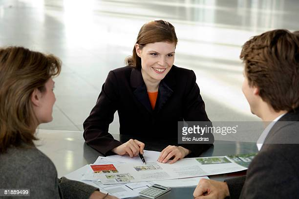 Real estate agent explaining to a couple