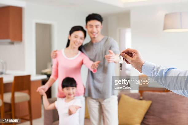 Real estate agent giving family key
