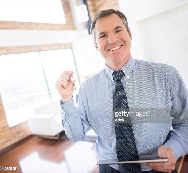 Real estate agent holding keys to a house