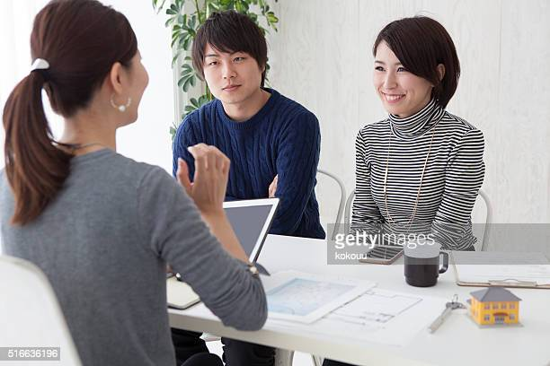 real estate agent is description to couple about  new house - real estate office stock photos and pictures