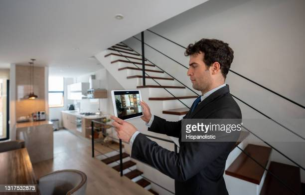 real estate agent making a virtual tour of a house - exploration stock pictures, royalty-free photos & images