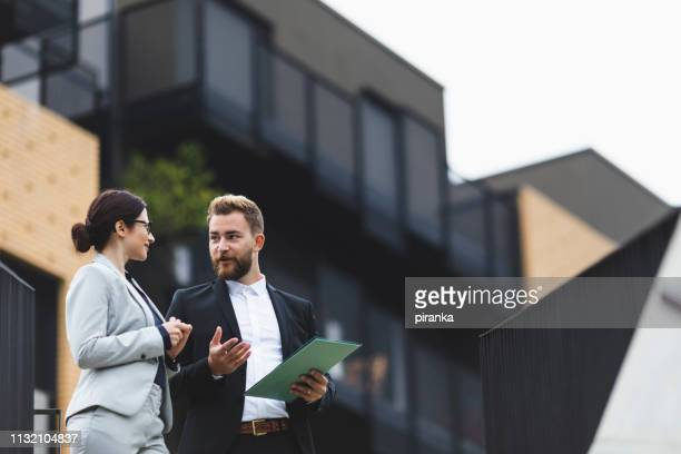 real estate agent on a meeting - real estate agent stock pictures, royalty-free photos & images