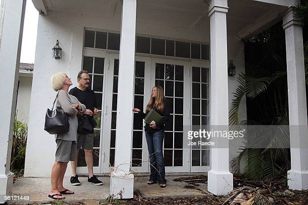 Real estate agent Shellie Young from Home and Business Realty Inc shows a short sale home to Myra Sandlin and David Sandlin on March 29 2010 in Miami...