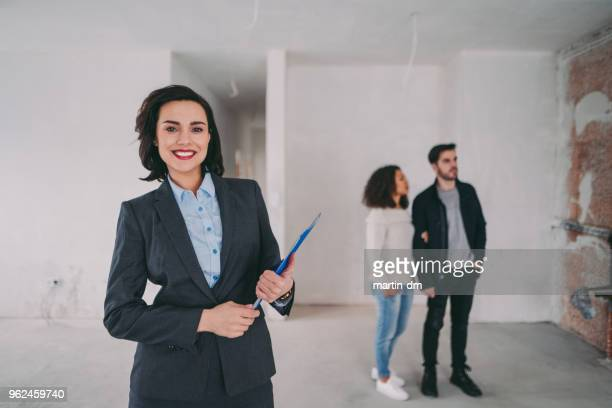 Real estate agent showing new home to clients