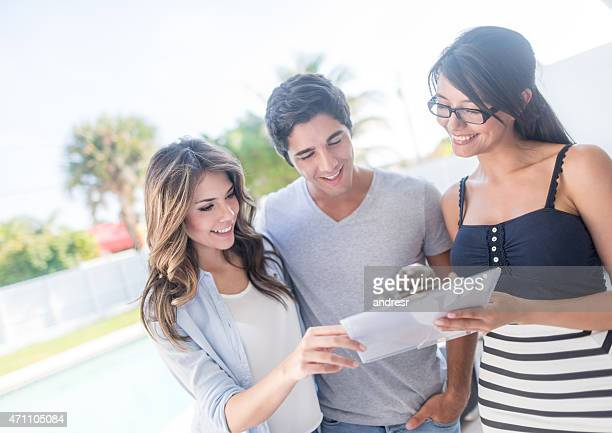 Real estate agent talking to a couple