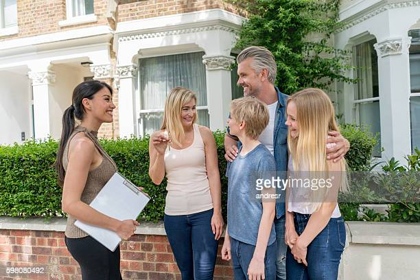 Real estate agent talking to a family