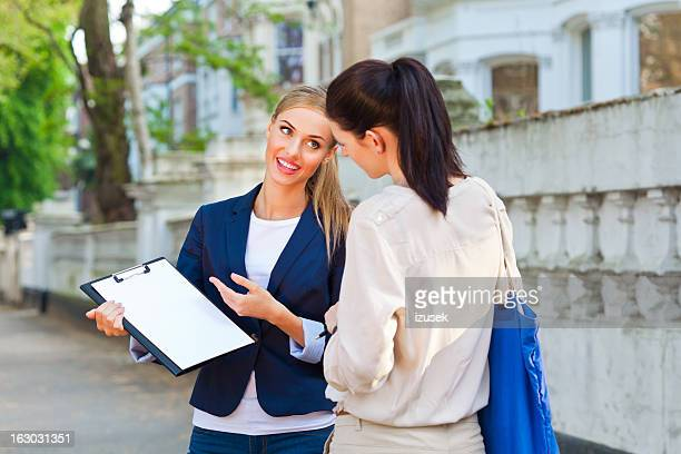 Real Estate Agent talking with client
