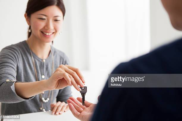 Real estate agent that customers are passing key