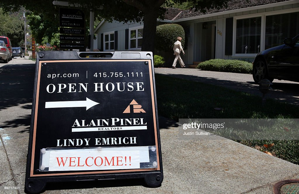 A real estate agent walks into a home during a brokers open house July 23, 2009 in San Rafael, California. The National Association of Realtors reported today that sales of existing homes were up for the third consecutive month, rising 3.6 percent in June.