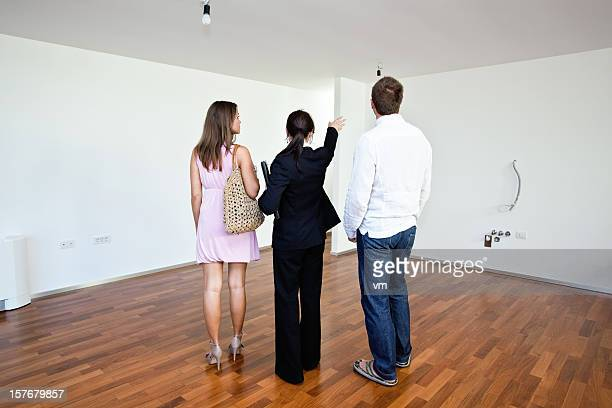 Real estate agent with customers