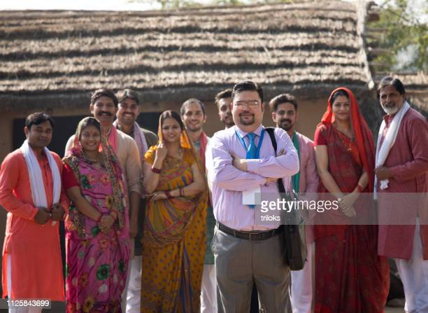 Real estate agent with group of villagers