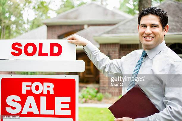 real estate agent with home for sale, sold sign. - estate agent sign stock pictures, royalty-free photos & images