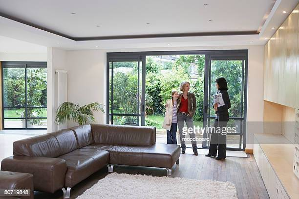 Real Estate Agent with Mother and Daughter in New Home