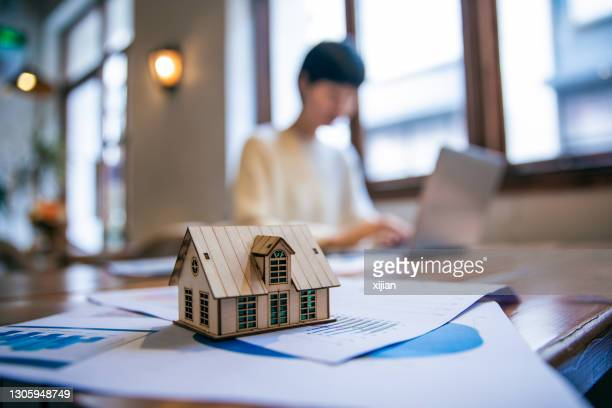 real estate agent working on laptop - tax stock pictures, royalty-free photos & images