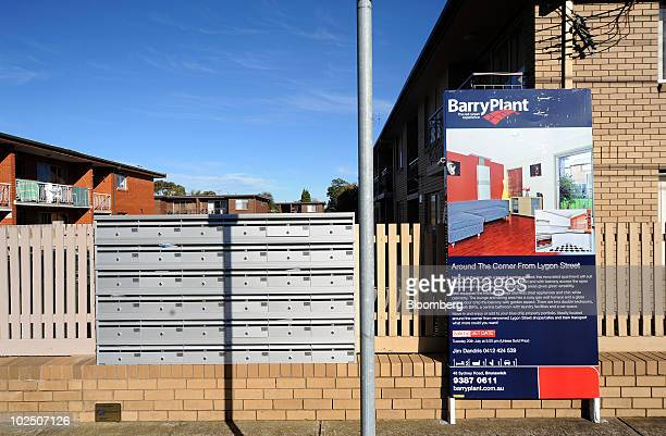 Real estate agent's advertisement is mounted on the exterior of a property in Brunswick, a northern suburb of Melbourne, Australia, on Monday, June...
