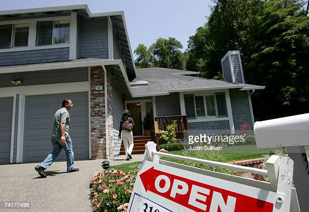 Real estate agents arrive at a brokers tour showing a house for sale with a list price of $1.3 million May 17, 2007 in San Rafael, California. The...