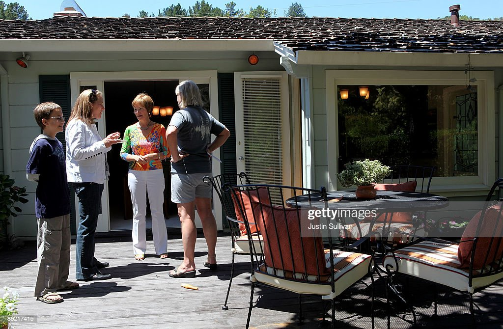 Real estate agents chat as they tour an open house during a brokers tour July 23, 2009 in San Rafael, California. The National Association of Realtors reported today that sales of existing homes were up for the third consecutive month, rising 3.6 percent in June.