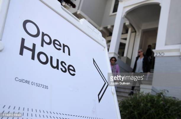 Real estate agents leave a home for sale during a broker open house on April 16, 2019 in San Francisco, California. In the wake of several tech...