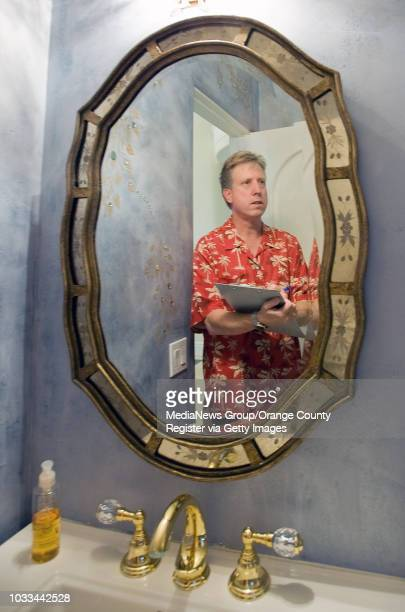 Real estate appraiser Dean Zibas looks at a bathroom featuring unique wallpaper while assessing the Anaheim Hills home ///ADDITIONAL shot 040914...