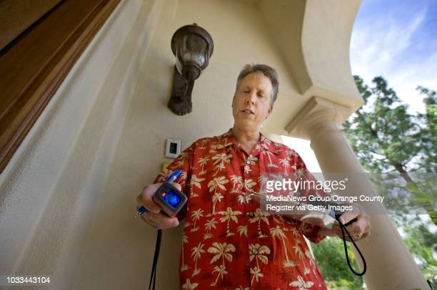 Real estate appraiser Dean Zibas uses a laser measurer to take dimensions of an Anaheim Hills home He says home owners should make a list of the...