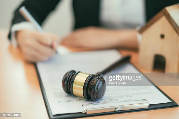 real estate concept, judge gavel and lawyer in auction with house model. - auction stock pictures, royalty-free photos & images