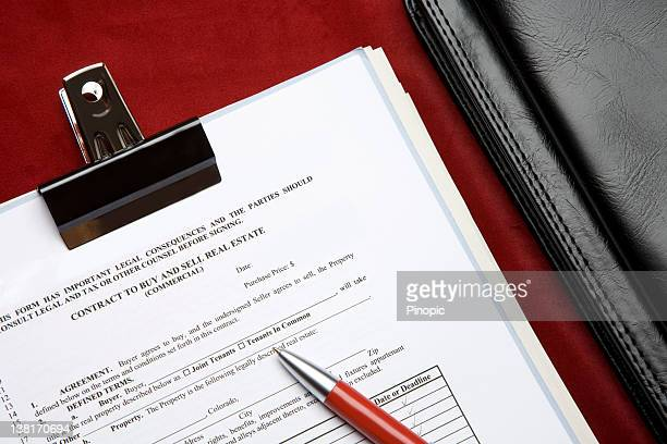 Real Estate contract and pen