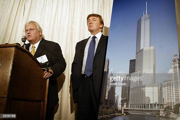 Real estate developer Donald Trump and architect Adrian Smith unveil an artists rendition of Trump Tower Chicago at a news conference September 23...
