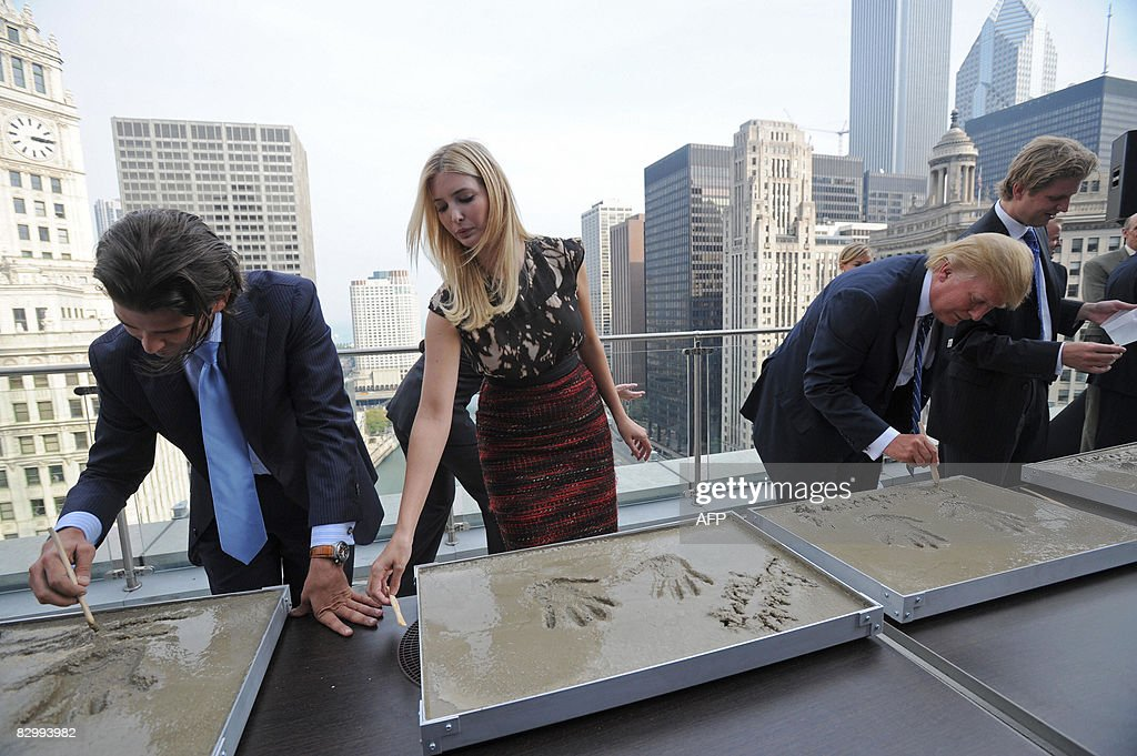 Real estate developer Donald Trump (2ndR) and his children (L-R), Donald Jr., Ivanka and Eric write their name in cement after making hand prints to inaugurate their father's new building, the Trump International Hotel and Tower in Chicago at a press conference on September 24, 2008. Trump's 1,360-foot (414.5-meter), 92-story tower is expected to be finished in six months and will stand as the second-tallest building in Chicago, after the Sears Tower. AFP PHOTO/Amanda Rivkin