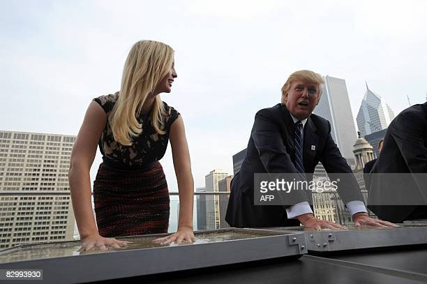 Real estate developer Donald Trump and his daughte Ivanka make hand prints during a press conference at the Trump International Hotel and Tower in...