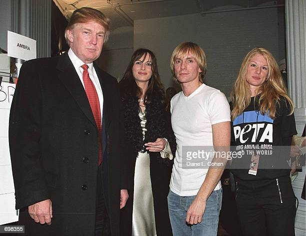 Real Estate Developer Donald Trump his companion Melania Knauss designer Marc Bouwer and an unidentified People for the Ethical Treatment of Animals...