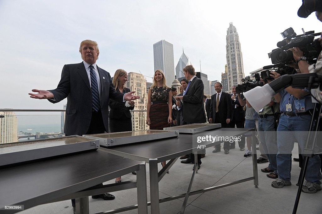 Real estate developer Donald Trump jokes with the press before making a hand print at a press conference at the Trump International Hotel and Tower in Chicago on September 24, 2008. Trump's 1,360-foot (414.5-meter), 92-story tower is expected to be finished in six months and will stand as the second-tallest building in Chicago, after the Sears Tower. AFP PHOTO/Amanda Rivkin