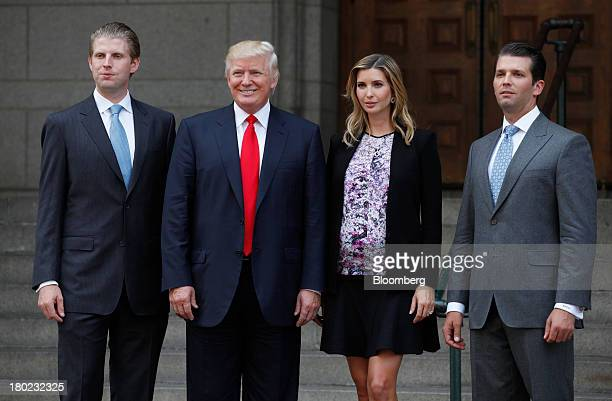 Real estate developer Donald Trump second from left stands for a photo with sons Eric Trump left Donald Trump Jr right and daughter Ivanka Trump...
