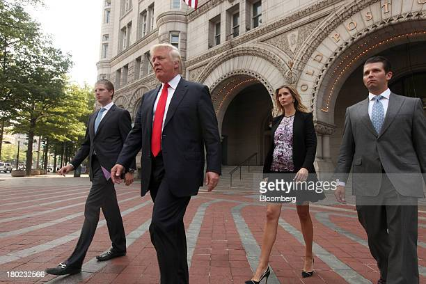 Real estate developer Donald Trump second from left walks with sons Eric Trump left Donald Trump Jr right and daughter Ivanka Trump walk outside the...