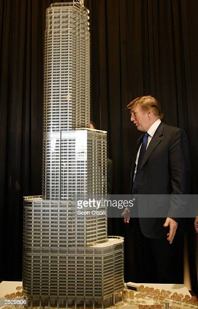 Real estate developer Donald Trump stands next to a model of Trump Tower Chicago at a news conference September 23 2003 Chicago Illinois The 90story...