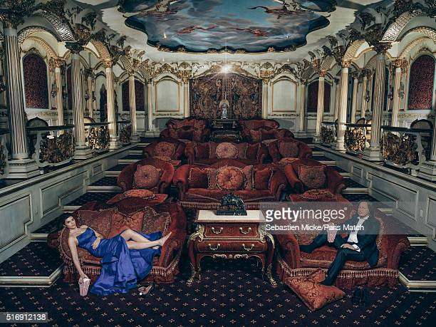 Real estate developer Mohamed Hadid is photographed in the cinema room within his Le Belvedere mansion with his fiancée Shiva Safai for Paris Match...