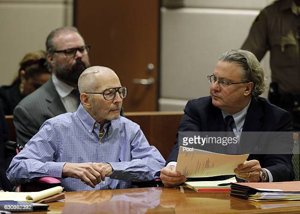 Real Estate Heir Robert Durst looks at attorney David Z Chesnoff as they appear in the Airport Branch of the Los Angeles County Superior Court during...