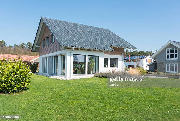 real estate home with garden meadow - einfamilienhaus - give way stock pictures, royalty-free photos & images