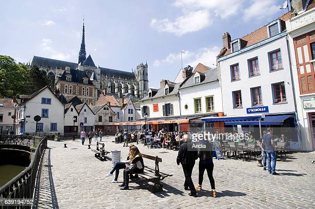 """Real estate in Amiens : real estate in the square """"place Duon"""" in downtown Amiens, with cafe terraces and the cathedral in the background."""