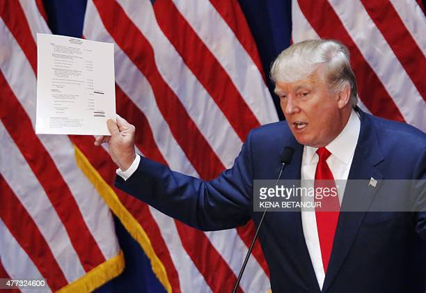 Real estate investor Donald Trump displays his financial statement during his announcement that he will run for the 2016 presidential election at the...