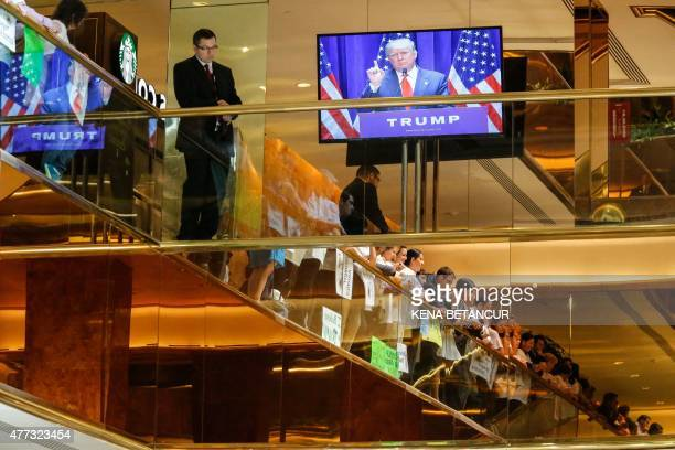 Real estate mogul Donald Trump is seen on a monitor as he announces his bid for the presidency in the 2016 presidential race during an event at the...