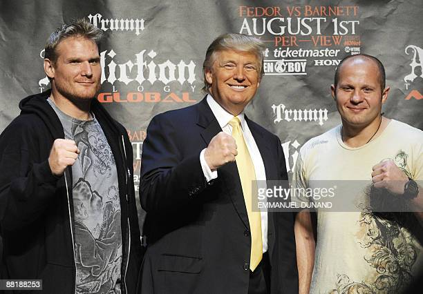 US real estate mogul Donald Trump poses with Mixed Martial Art heavyweight fighters US Josh Barnett and Russia's Fedor Emelianenko in New York on...