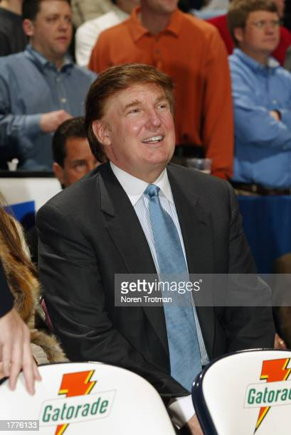 Real Estate Mogul Donald Trump sits courtside of the Washington Wizards and New Jersey Nets game at Continental Airlines Arena on January 29 2003 in...