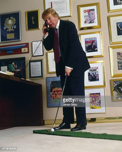 Portrait of businessman and celebrity media personality Donald Trump putting during photo shoot in his office New York NY CREDIT Simon Bruty