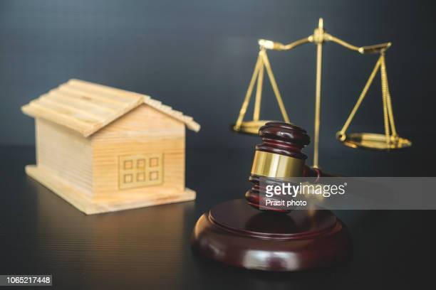 Real estate sale auction concept - gavel and house model.