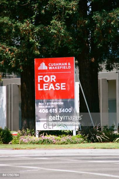 Real estate sign from Cushman and Wakefield on a commercial building for lease in the Silicon Valley Santa Clara California August 17 2017 Real...