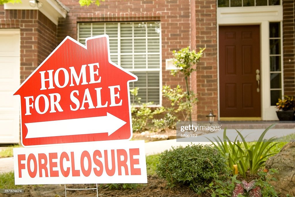 Real Estate Sign in yard of foreclosure house. For sale. : Stock Photo