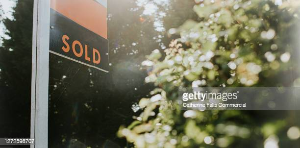 'sold' real estate sign outside a property - house stock pictures, royalty-free photos & images